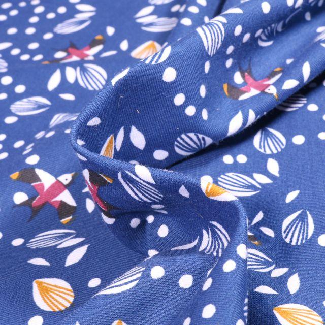 Tissu Jersey Coton Arty Jolhiro sur fond Bleu