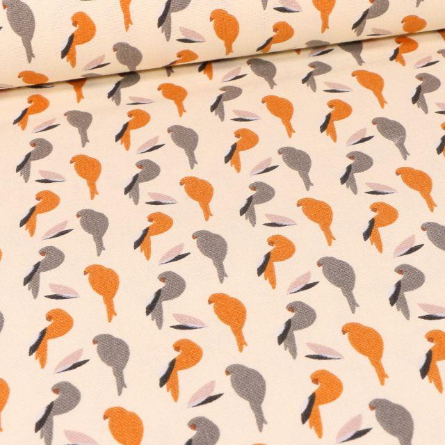 Tissu Toile de Coton Perko orange sur fond Blanc cassé