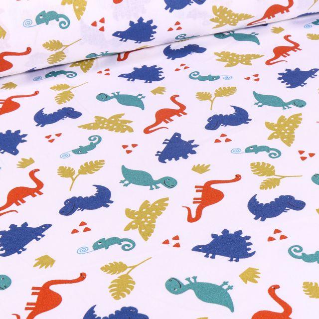 Tissu Coton imprimé Arty Dinosaures et caméléon sur fond Blanc