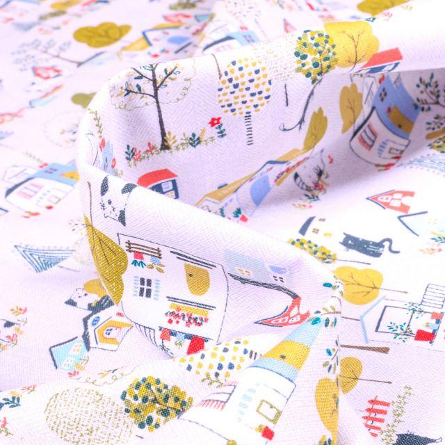 Tissu Coton imprimé QT Fabrics Little Village jaune sur fond Blanc