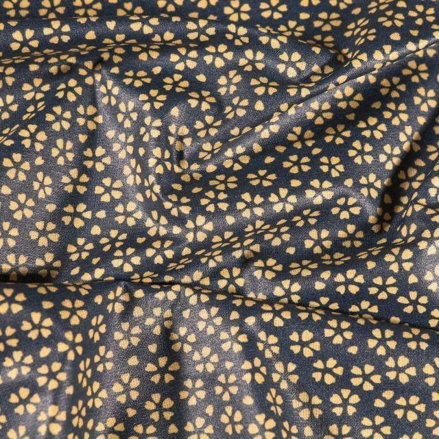 Tissu Coton enduit Myosotis sur fond Bleu denim - Par 10 cm