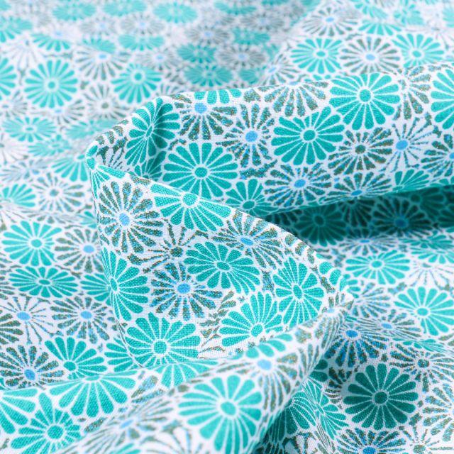 Tissu Coton imprimé Arty Nikki sur fond Bleu turquoise