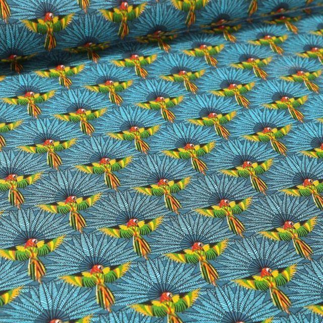 Tissu Coton imprimé Arty Perroquet et plumes sur fond Bleu - Par 10 cm