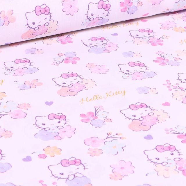 Tissu Hello Kitty Flowers sur fond Rose pâle