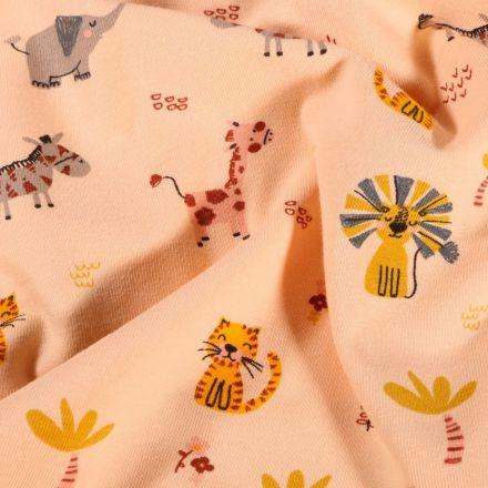 Tissu Jersey Coton Animaux de la savane sur fond Saumon - Par 10 cm