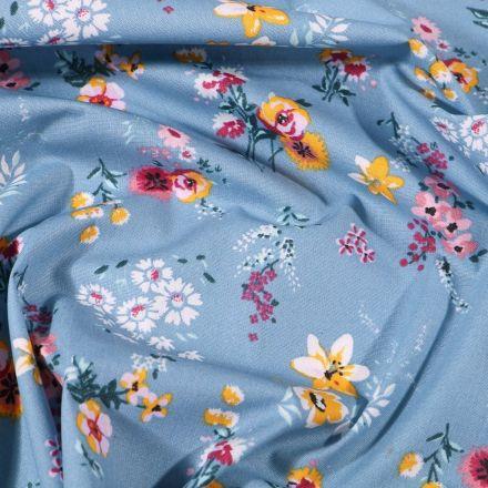 Tissu Coton enduit Fleuris sur fond Bleu - Par 10 cm