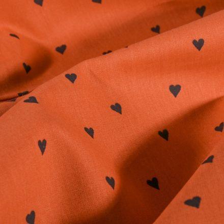 Tissu Coton imprimé LittleBird Petits cœurs noir sur fond Rouille - Par 10 cm