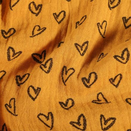 Tissu Double Gaze Cœurs dessinés sur fond Moutarde - Par 10 cm