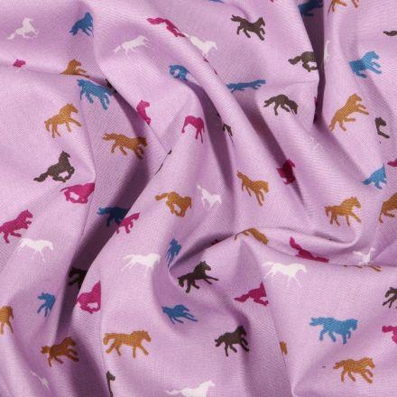 Tissu Coton imprimé Chevaux multicolores sur fond Mauve - Par 10 cm
