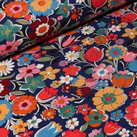 Tissu Jersey Coton Fleurs printanières sur fond Bleu marine - Par 10 cm