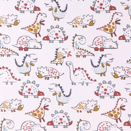 Tissu Jersey Coton Arty Gentils dinosaures Rouges, bleus et ocre sur fond Ecru - Par 10 cm