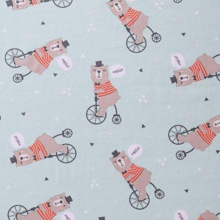 Tissu Jersey Arty Ours à vélo Marron, orange et noir sur fond Menthe - Par 10 cm