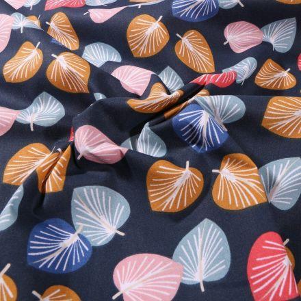 Tissu Coton imprimé Arty Feuilles colorées sur fond Bleu marine - Par 10 cm