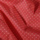 Tissu Coton enduit Petits pois blancs sur fond Corail - Par 10 cm