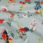 Tissu Coton enduit Bouquets de fleurs sur fond Menthe - Par 10 cm