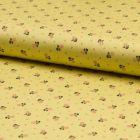 Popeline de coton satiné Romantico Petites fleurs saumon et noires sur fond Jaune - Par 10 cm